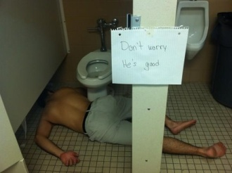 COLLEGE-dude-passed-out-in-bathroom-with-sign-saying-not-to-worry