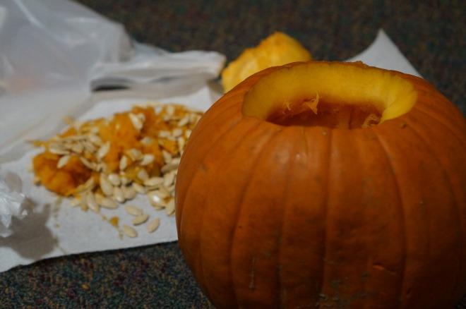 De-seeding a pumpkin.